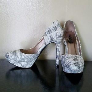 Charlotte Russe Snakeskin pointy toed heels.